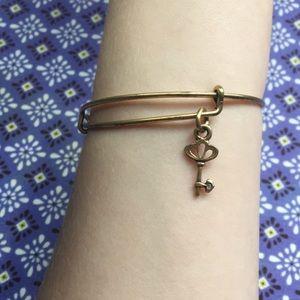 Gold Alex and Ani bracelet with key